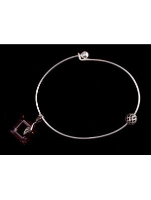 Bracelet boule avec charms et carré cristal rouge évidé